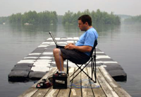 Roland uses his laptop to control an AUV in Mendum's Pond.