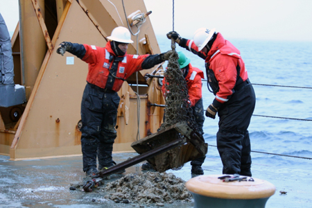 Dumping the contents of the dredge bucket on Healy's deck.