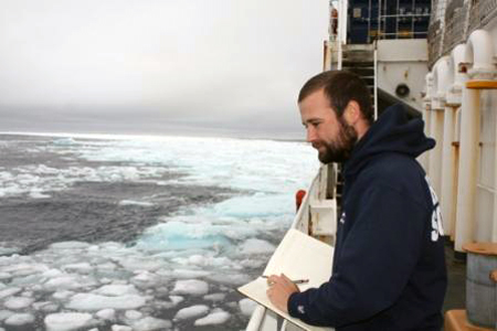 Matt Ayre observing sea ice from Healy's deck.