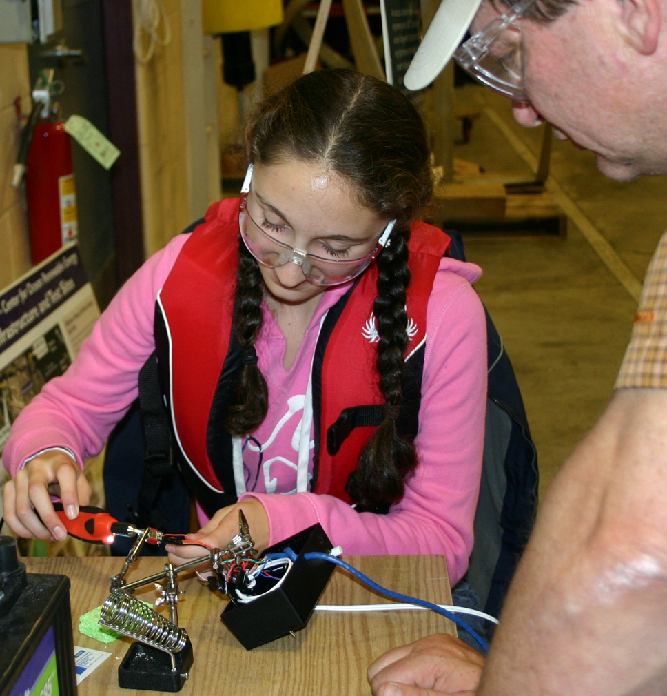 SeaPerch participants solders a part on her ROV.