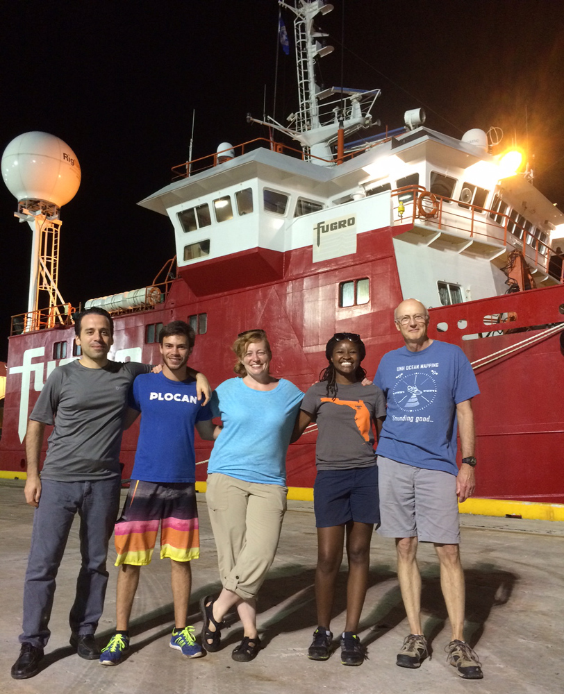 The survey team posed in front of the Fugro ship.