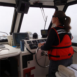 Capt. Emily Evans at the helm