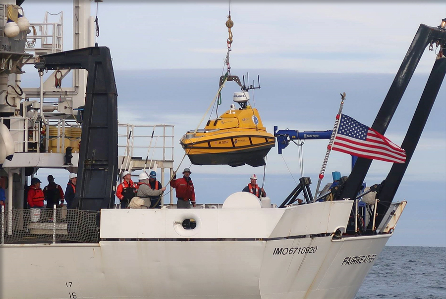 The BEN ASV suspended over the deck of the NOAA Ship Fairweather.
