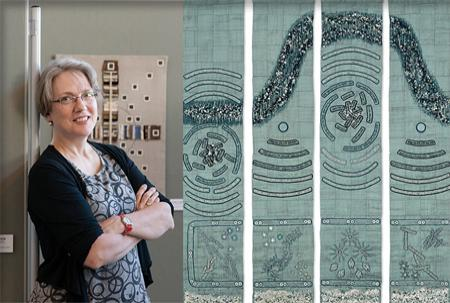 Artist Lindsay Olson poses next to one of her textile art pieces.