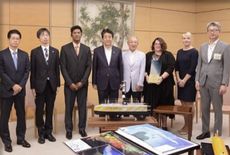Members of the GEBCO-NF Alumni XPRIZE team pose with Japanese Prime Minister Shinzo Abe