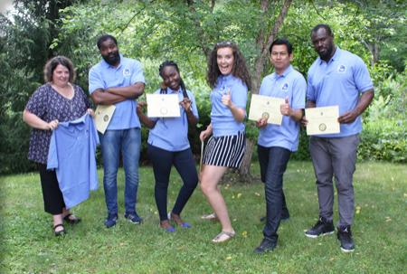 Five GEBCO Students pose with in matching shirts with their certificates while GEBCO director Roxy Wigley holds shirt representing absent classmate.