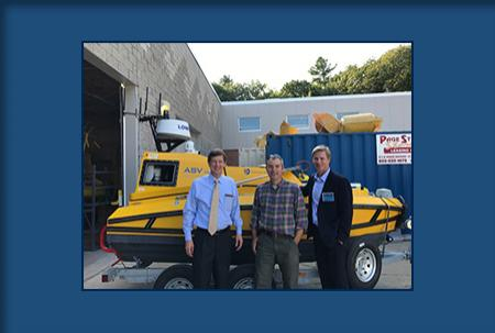 Photo of Val Schmidt with visitors in front of the C-Worker 4 ASV.