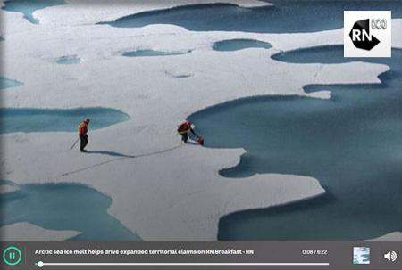 Two people on ice floe surrounded by melt water.