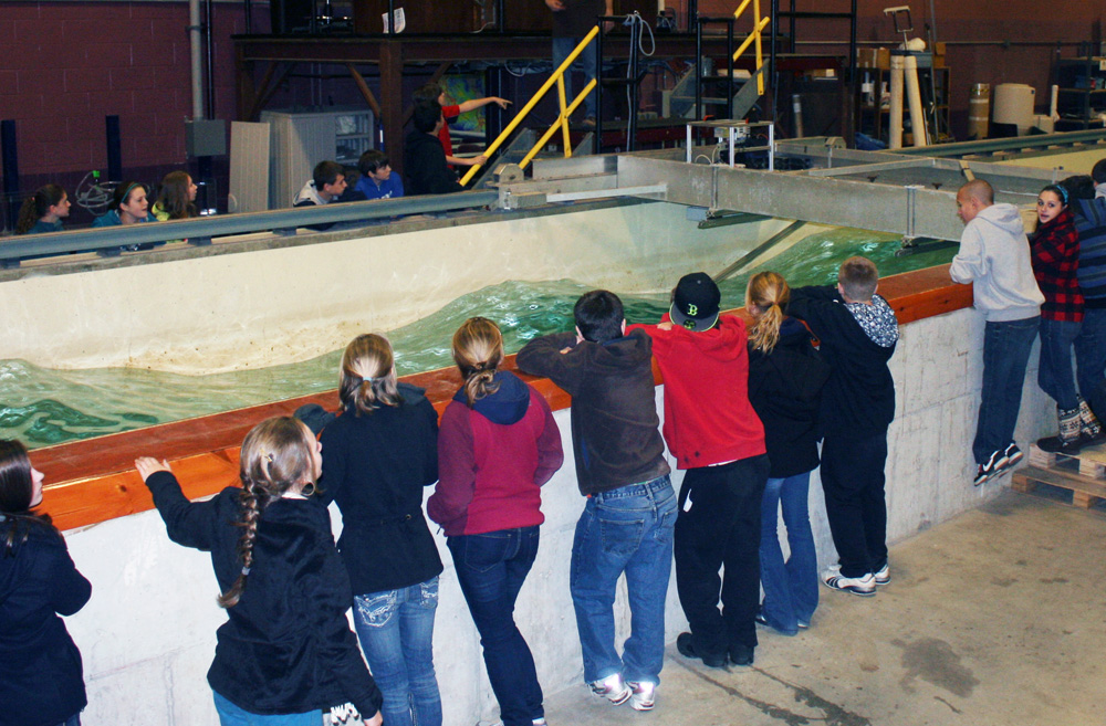 Visitors watch as waves are generated in the wave tank.