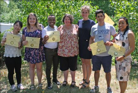 GEBCO director Rochelle Wigley poses with the six GEBCO scholars who are holding their certificates.